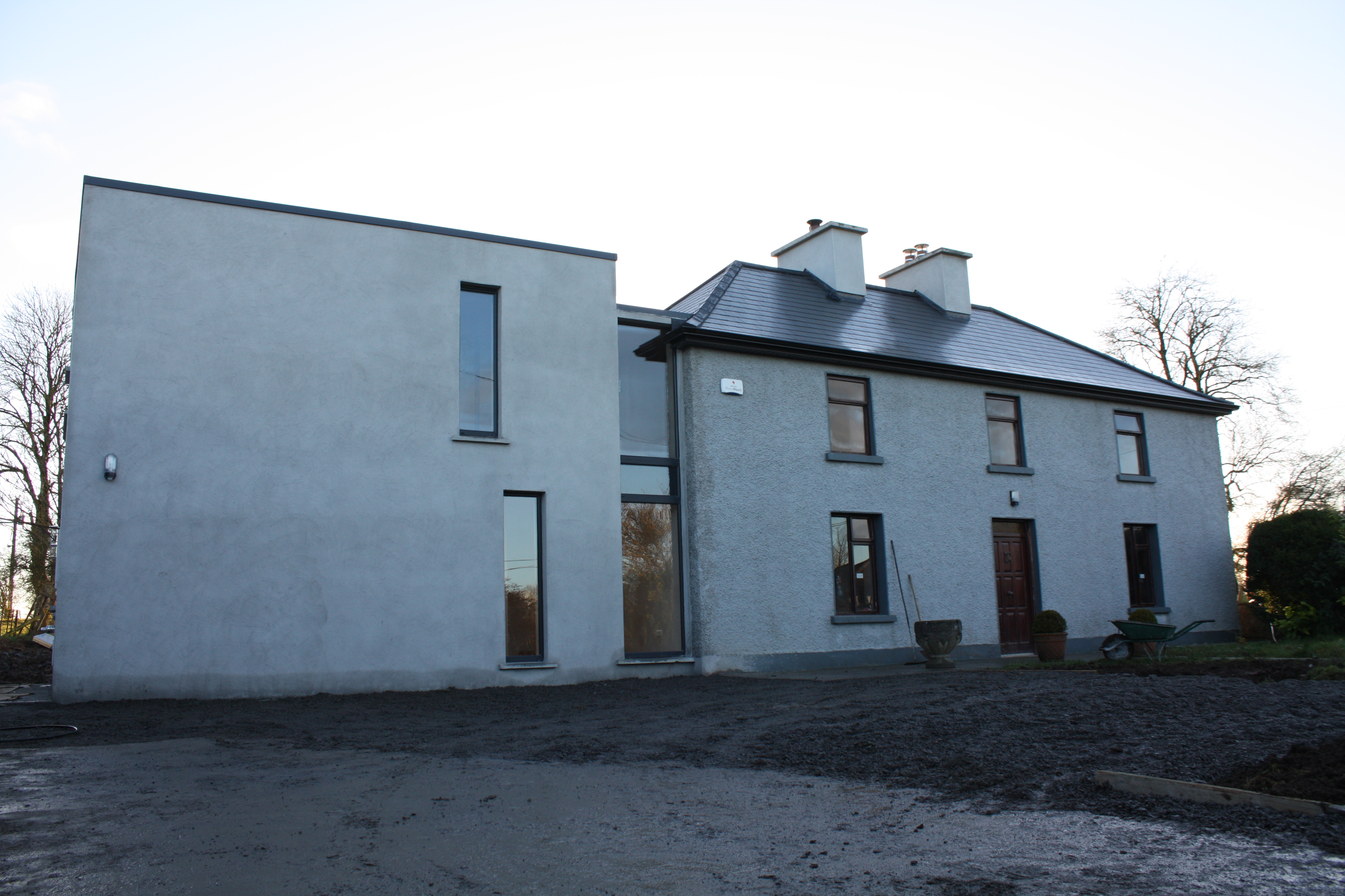 two storey modernist extension to contemporary farmhouse mark